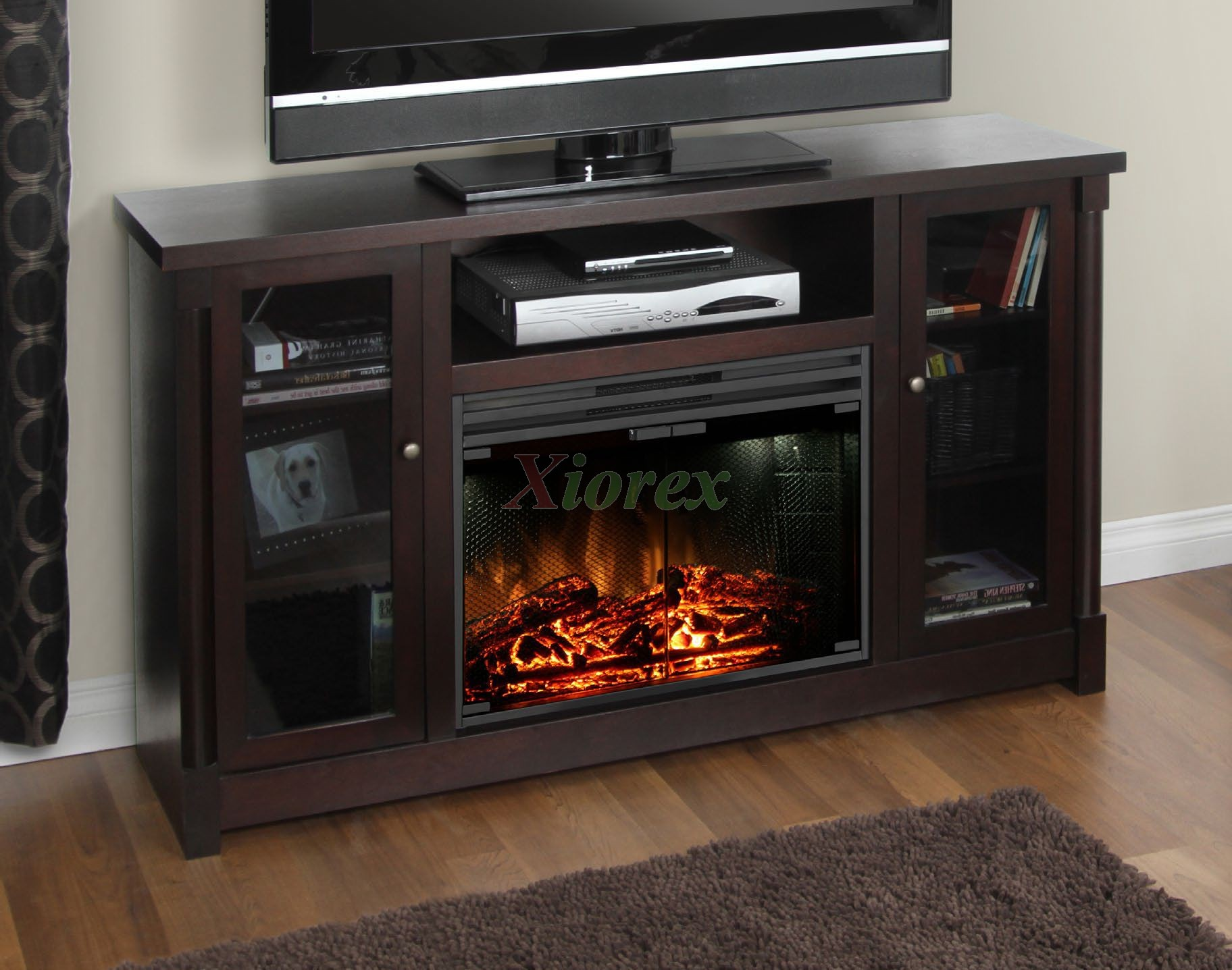 "Muskoka Coventry media stand fireplace holds up to a 60"" flat panel TV. This sleek and sophisticated model provides shelving for electronic components and space saving storage compartments behind classic cabinet style glass doors."